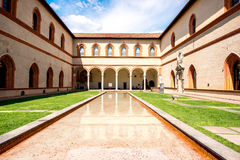 Sforza castle in Milan. Inner yard of Sforza castle with fountain in Milan city stock photo