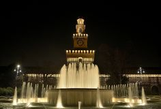 Sforza Castle night scene. A night view of the Sforza Castle (Castello Sforzesco) and the fountain in front of it at night in Milan, Italy stock photo