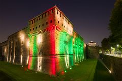 Sforza`s castle in a multicolored night illumination. Milan, Italy Royalty Free Stock Photography