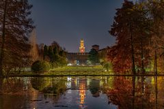 Sforzesco Castle and the park dressed with autumn colors in Milan by night royalty free stock photos