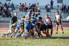 Sforzo di momento del gruppo di lavoro di squadra di rugby Immagine Stock