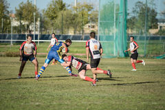 Sforzo di momento del gruppo di lavoro di squadra di rugby Fotografia Stock