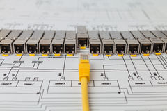 SFP network modules for network switch and patch cord. Electric gigabit sfp modules for network switch on the blueprint of communication equipment and patch cord royalty free stock photography