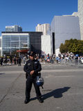 SFPD Police officer stand on street with helmet resting on hip Stock Images