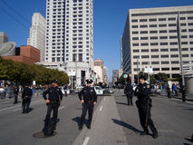 SFPD Police officers stand on street as protesters of Marijuana. SAN FRANCISCO, CA - OCTOBER 25: SFPD Police officers stand on blocked street as protesters of royalty free stock image