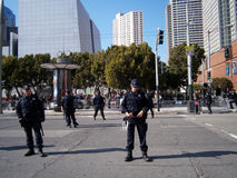 SFPD Police officers stand on street as protesters of Marijuana Stock Photography