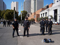 SFPD Police officers stand on street talking as protesters of Ma Royalty Free Stock Photos
