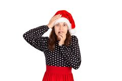 Sfrustowana kobieta czuje niespokojnych, zdziwionych i kąsków palca gwoździe w zaintrygowaniu emocjonalna dziewczyna w Santa Clau zdjęcia royalty free