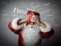 Sfrustowany Święty Mikołaj i wiele życzenia zdjęcie royalty free
