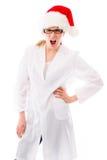 Sfrustowany żeński naukowiec jest ubranym Santa kapelusz zdjęcia stock