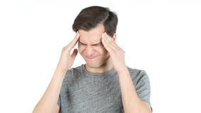 Sfrustowany i Zmęczony młody człowiek z migreną - odizolowywającą nad bielem zdjęcie stock