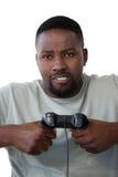 Sfrustowany mężczyzna mienia joystick przeciw białemu tłu obraz stock