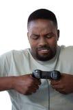 Sfrustowany mężczyzna mienia joystick przeciw białemu tłu obrazy stock