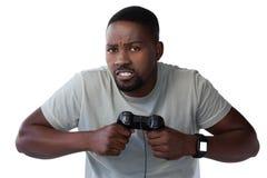 Sfrustowany mężczyzna mienia joystick przeciw białemu tłu fotografia royalty free