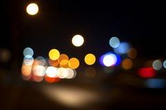 Sfuocatura astratta della luce notturna della città Fotografia Stock Libera da Diritti