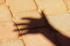 Sfuocatura dell'ombra della mano Immagine Stock