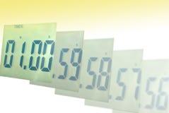 Sfuocatura dell'orologio di Digitahi ad un minuto Fotografia Stock