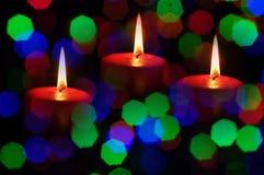 Sfuocatura delle candele di Natale Fotografia Stock Libera da Diritti