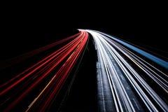 Sfuocatura di movimento occupata di traffico di notte Fotografie Stock Libere da Diritti