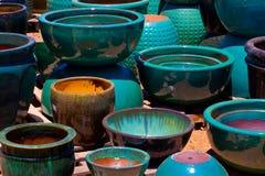 Sfuocatura e vasi arancio per le piante Fotografie Stock