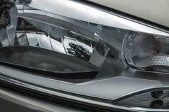 Sfuocature di riflessioni dei modelli e strutture della lampada della testa del veicolo Fotografie Stock Libere da Diritti