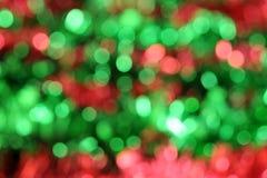 Sfuocature di verde e di colore rosso Fotografia Stock