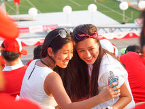 SG50 - Singapore's 50th Birthday Celebration. Girls taking selfie during NDP preview Stock Image