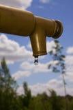 Sgocciolatura del rubinetto Fotografie Stock