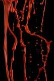 Sgocciolatura rossa della vernice fotografie stock