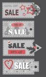 Sgualcisca le etichette di natale con l'offerta di vendita Immagini Stock Libere da Diritti