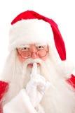 Sguardi del Babbo Natale intento attraverso i suoi vetri direttamente al Fotografie Stock