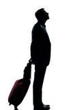 Sguardo attendente del viaggiatore di affari dell'uomo in su Fotografia Stock