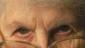 Sguardo della donna molto anziana Fotografia Stock Libera da Diritti