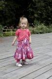 sguardo della ragazza di fiore del bambino Fotografia Stock Libera da Diritti