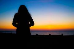 Sguardo fisso distante di tramonto Immagini Stock