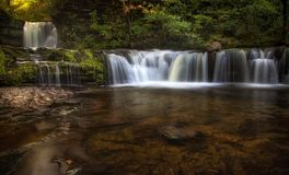 Sgwd Ddwli Isaf waterfalls South Wales. Sgwd Ddwli Isaf waterfalls on the river Neath, part of the waterfall country trail of falls, near Pontneddfechan in South Stock Image