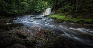 Sgwd Ddwli Uchaf vattenfall södra Wales royaltyfri fotografi