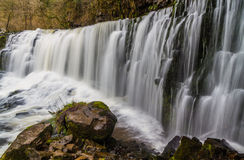Sgwd Isaf Clun-Gwyn waterfall. On the river Afon Mellte South Wa. Sgwd Isaf Clun-Gwyn Falls, waterfall. Near Pontneddfechan, Vale of Neath, Powys, Wales, United Stock Photography