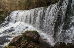 Sgwd Isaf Clun-Gwyn waterfall. On the river Afon Mellte South Wa. Sgwd Isaf Clun-Gwyn Falls, waterfall. Near Pontneddfechan, Vale of Neath, Powys, Wales, United Stock Photo