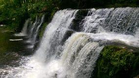 Sgwd y Pannwr瀑布在布雷肯比肯斯山国家公园,威尔士,英国 免版税库存图片