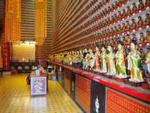 Numerous Buddha statues, incorporated in the walls of the Ten Thousand Buddhas Monastery stock image