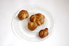 Shabat challah on transparent plate. Four challah bread on a decorated plate. Shows the preparation for Shabbat stock photography