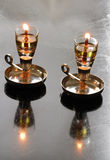 Shabbat candles. Two Shabbat oil candles in brass cup holders royalty free stock photos