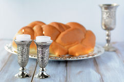 Shabbat candles with Challah and wine Stock Images
