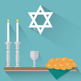 Shabbat candles, kiddush cup and challah. Royalty Free Stock Image