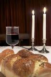 Shabbat Celebration. Items used for Shabbat, candlesticks, lit candles,Challah,glass of wine Royalty Free Stock Photos