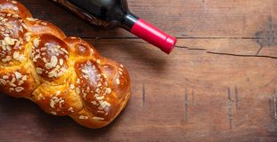 Challah bread with a bottle of red wine on wooden table, copy space. Shabbat concept, challah bread with a bottle of red wine on wooden table, copy space, top stock photos