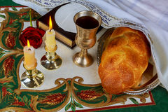 Shabbat eve table with challah bread, candles and kippah. Royalty Free Stock Photos