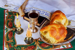 Shabbat eve table with challah bread, candles and kippah. Stock Photography