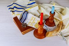 Shabbat eve table with covered candles. Shabbat eve table with covered challah bread, candles Stock Images